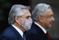 Argentina's President Alberto Fernandez attends a ceremony with Mexican President Andres Manuel Lopez Obrador at the National Palace in Mexico City, Tuesday, Feb. 23, 2021, amid the COVID-19 pandemic. Fernandez is on a four-day official visit to Mexico. (AP Photo/Marco Ugarte)