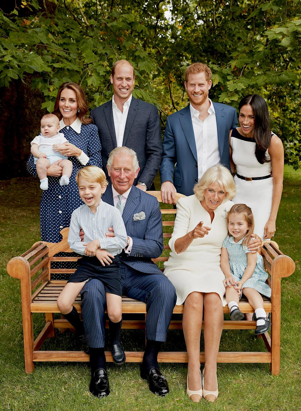 The photos shows Prince Charles and his wife, Camilla, the Duchess of Cornwall, sitting on a bench, surrounded by their family. Photo: Getty Images