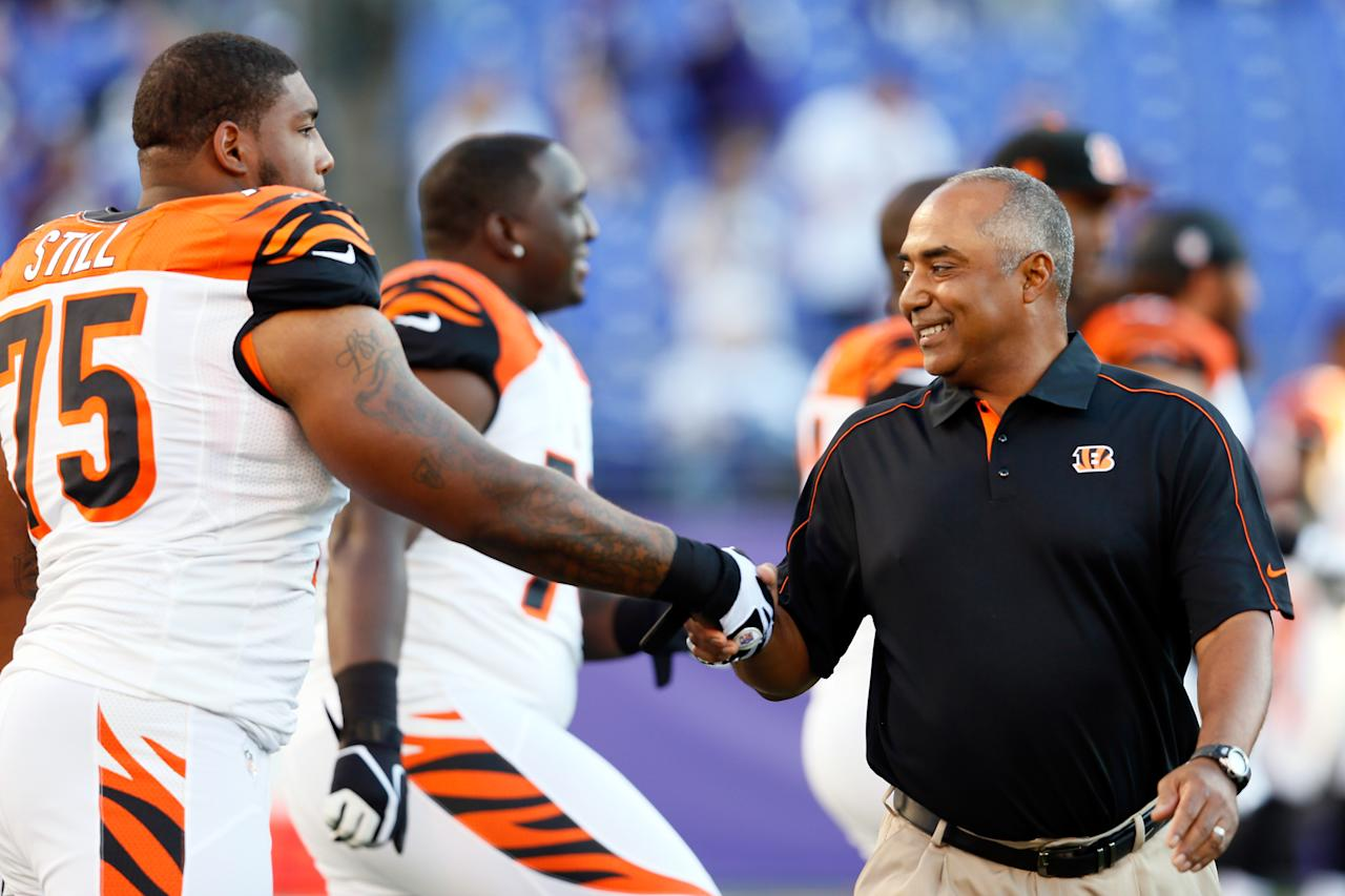 BALTIMORE, MD - SEPTEMBER 10:  Head coach Marvin Lewis of the Cincinnati Bengals greets defensive tackle Devon Still #75 of the Cincinnati Bengals as he comes onto the field to take on the Baltimore Ravens at M&T Bank Stadium on September 10, 2012 in Baltimore, Maryland.  (Photo by Rob Carr/Getty Images)