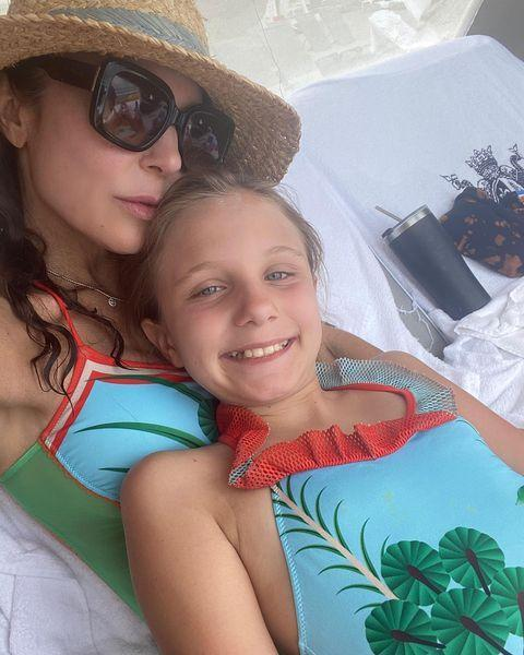 """<p>Bethenny Frankel celebrated Mother's Day 2021 with an <a href=""""https://www.instagram.com/p/COp8aUZhtkz/"""" rel=""""nofollow noopener"""" target=""""_blank"""" data-ylk=""""slk:Instagram post captioned"""" class=""""link rapid-noclick-resp"""">Instagram post captioned</a>, """"The bond between a mother and a child is infinite. It defines me, gives me purpose and is my true compass."""" </p> <p>In one photo, she and her daughter twin in matching one-piece bathing suits. </p>"""