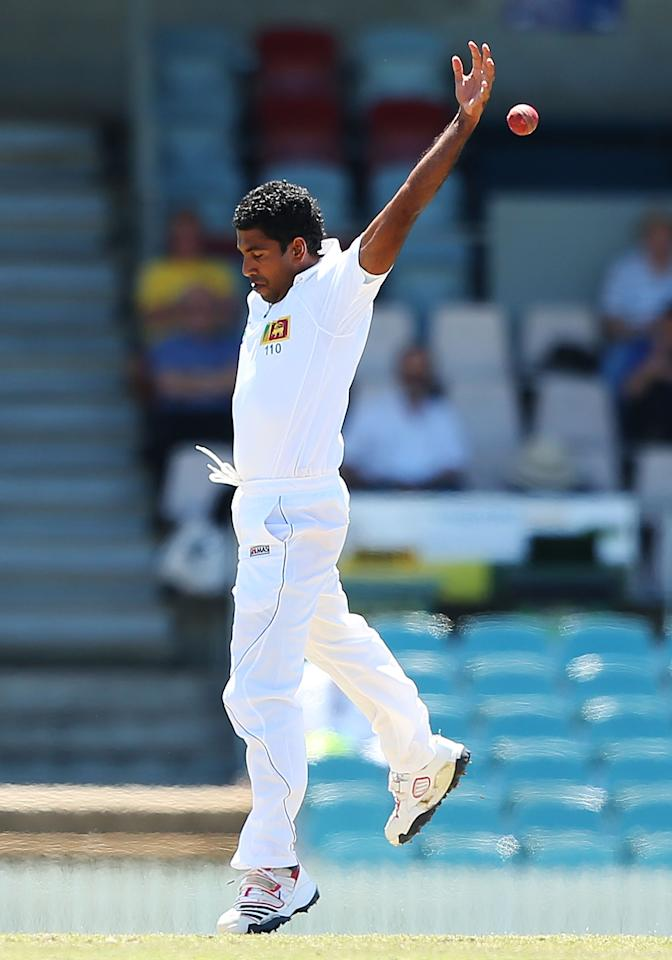 CANBERRA, AUSTRALIA - DECEMBER 06:  Dhammika Prasad of Sri Lanka fields during day one of the international tour match between the Chairman's XI and Sri Lanka at Manuka Oval on December 6, 2012 in Canberra, Australia.  (Photo by Brendon Thorne/Getty Images)