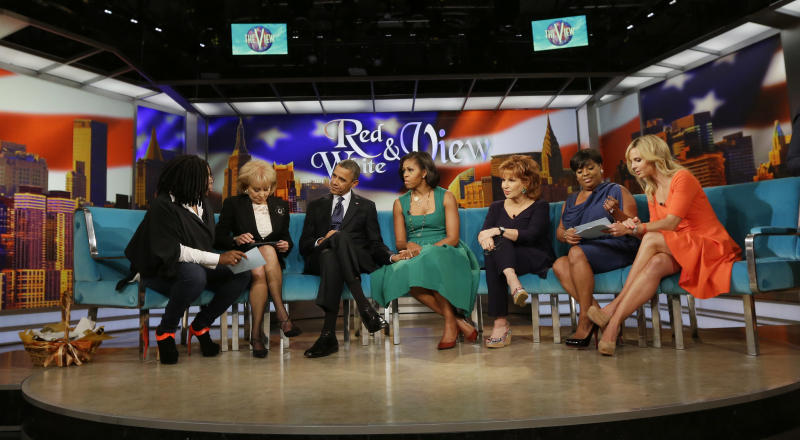 """President Barack Obama and first lady Michelle Obama appear on the ABC Television show """"The View"""" in New York, Monday, Sept. 24, 2012, From left are, Whoopi Goldberg, Barbara Walters, the president, the first lady, Joy Behar, Sherri Shepherd and Elisabeth Hasselbeck. (AP Photo/Pablo Martinez Monsivais)"""