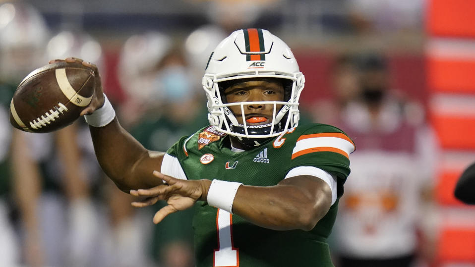 Miami quarterback D'Eriq King throws a pass during the first half of the Cheez-it Bowl NCAA college football game against Oklahoma State, Tuesday, Dec. 29, 2020, in Orlando, Fla. (AP Photo/John Raoux)