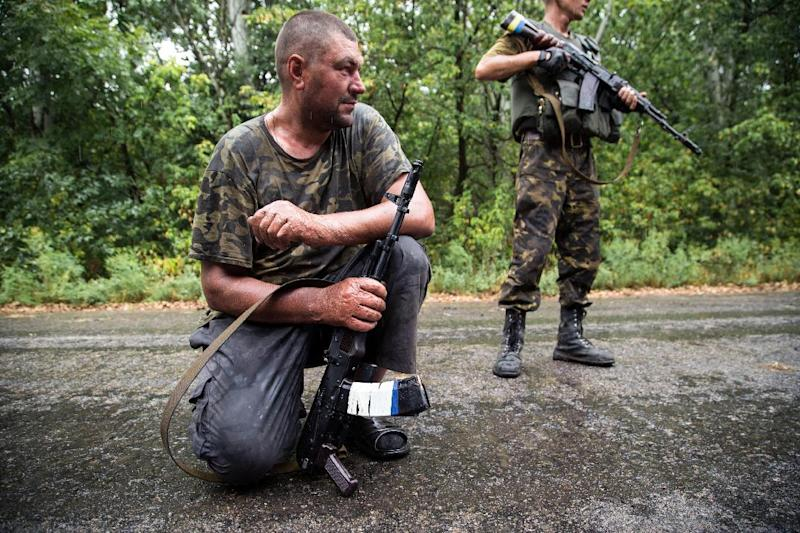 Ukrainian servicemen at a checkpoint in the Donetsk region, August 28, 2014. The prospect of a military confrontation between Ukraine and Russia has knocked market confidence (AFP Photo/Oleksandr Ratushniak)