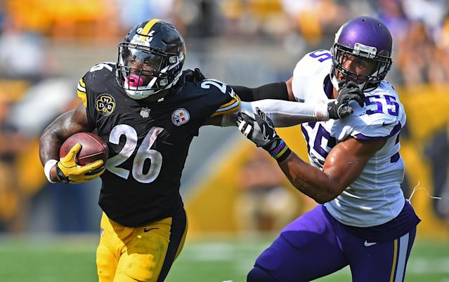 <p>Le'Veon Bell #26 of the Pittsburgh Steelers stiff arms Anthony Barr #55 of the Minnesota Vikings as he carries in the ball in the second half during the game at Heinz Field on September 17, 2017 in Pittsburgh, Pennsylvania. (Photo by Joe Sargent/Getty Images) </p>