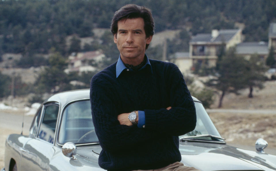 Pierce Brosnan poses against an Aston Martin DB5 in a publicity still for the James Bond film 'GoldenEye'. (Photo by Keith Hamshere/Getty Images)