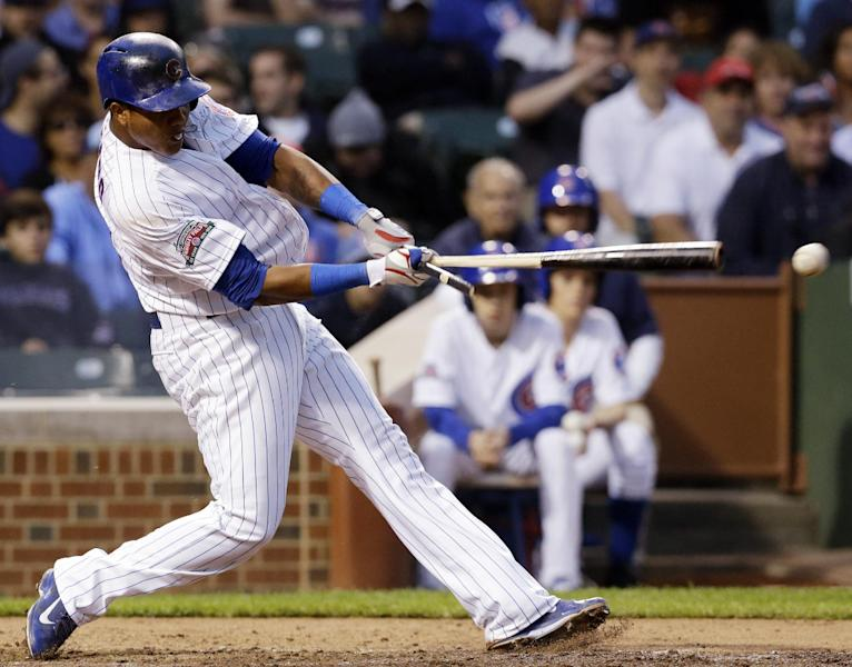 Chicago Cubs' Starlin Castro hits a two-run single during the fourth inning of a baseball game against the Washington Nationals in Chicago, Thursday, June 26, 2014. (AP Photo/Nam Y. Huh)