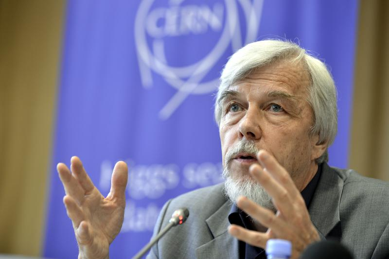 "Rolf Heuer, Director General of CERN (European Organization for Nuclear Research), answers journalist's question about the scientific seminar to deliver the latest update in the search for the Higgs boson at the European Organization for Nuclear Research (CERN) in Meyrin near Geneva, Switzerland, Wednesday, July 4, 2012. The head of the world's biggest atom smasher is claiming discovery of a new particle that he says is consistent with the long-sought Higgs boson known popularly as the ""God particle."" Rolf Heuer, director of the European Center for Nuclear Research, or CERN, says ""we have a discovery"" of a new subatomic particle, a boson, that is ""consistent with a Higgs boson."" He spoke after two independent teams at CERN said they have both ""observed"" a new boson that looks just like the one believed to give all matter in the universe size and shape. (AP Photo/Keystone/Martial Trezzini)"