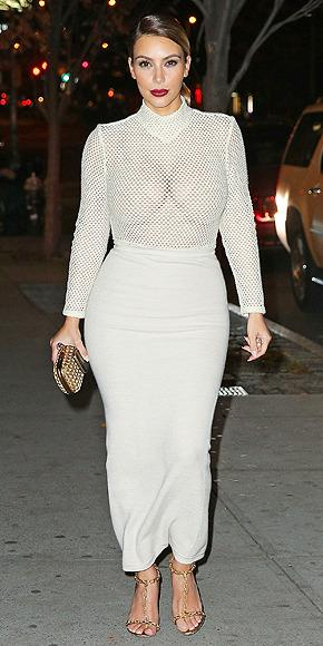 <p><b>N.Y.C. NIGHTS 2015</b><br>  Turtlenecks are risky. Mesh turtlenecks are even riskier. Especially when paired with a lycra high-waisted pencil skirt. (NOTE: Kim was going for a casual dinner with her friend Simon Huck in this photo.)</p>