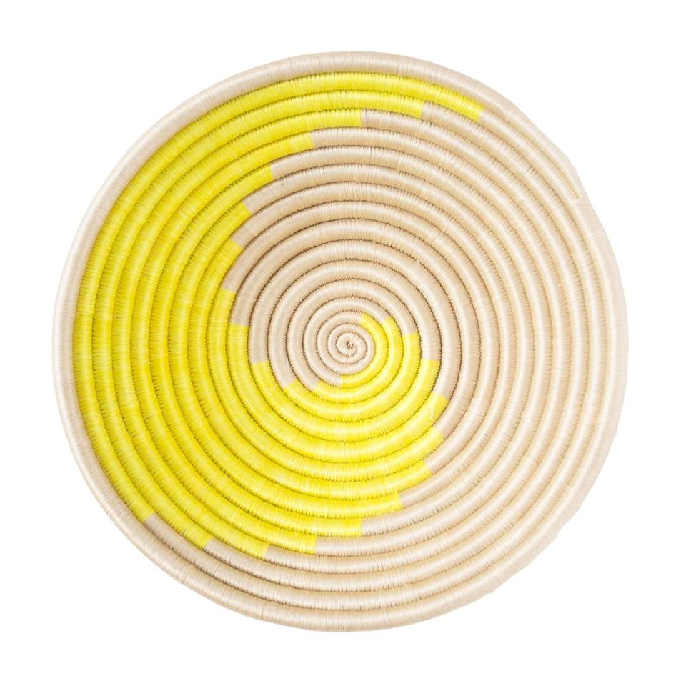 <p>This <span>Indego Africa Handmade 12x3 Citron Swirl Plateau Woven Basket</span> ($65) is so useful to have around the house. Plus, it makes for a gorgeous decor piece.</p>