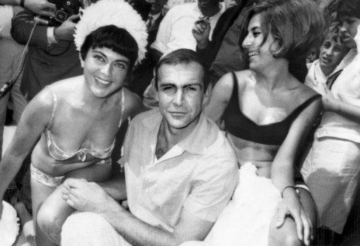 'Bond' star Sean Connery poses with two women in Cannes in 1965. A series of events are to be held around the world on October 5 to mark the 50th anniversary of the Bond films, the iconic spy saga that helped define half-a-century of cultural, political and technological upheaval