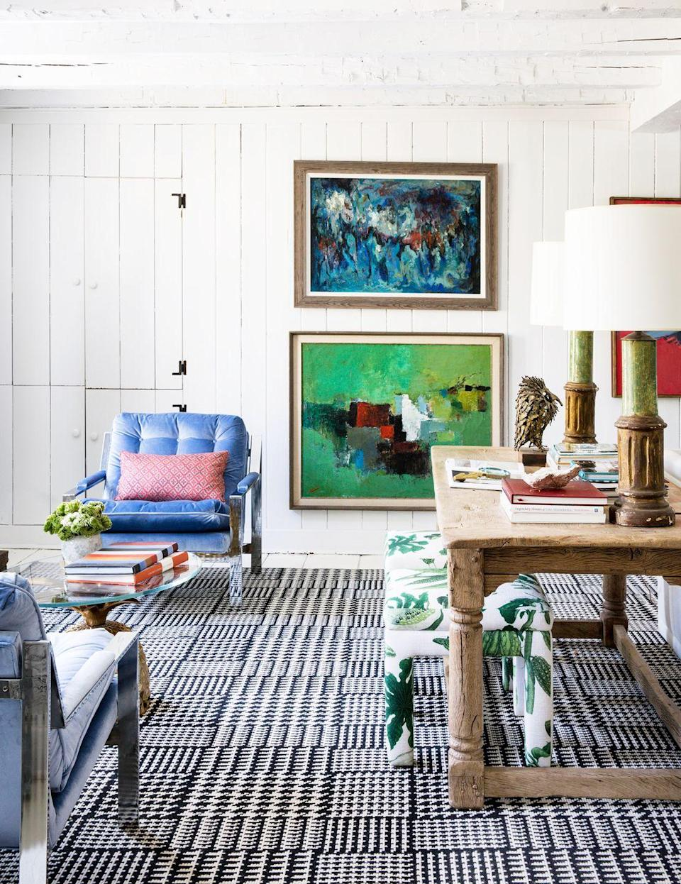 """<p>Interior designer <a href=""""https://andrewflesher.com/"""" rel=""""nofollow noopener"""" target=""""_blank"""" data-ylk=""""slk:Andrew Flesher"""" class=""""link rapid-noclick-resp"""">Andrew Flesher</a> restored his historic White Plains home with bursts of fun colors, unexpected pattern play (who knew banana leaf fabric and a tight houndstooth print carpet could complement each other so nicely?), and gallons of bright white paint. Consider it proof that you don't have to strip and replace all the the original wood surfaces to brighten and modernize a space so completely. The eclectic layering is such a nice way to honor the historic bones while marking its design forward present. </p>"""
