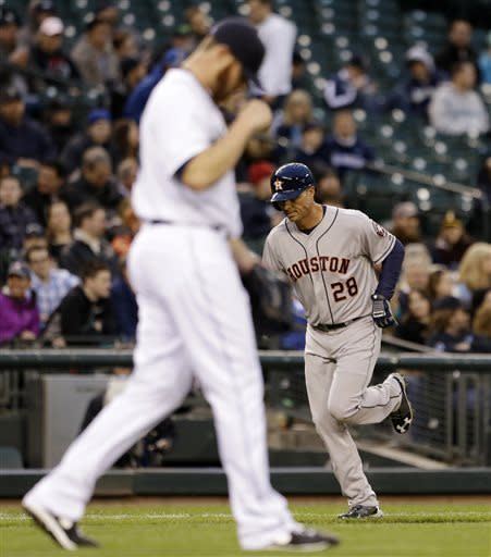 Houston Astros' Rick Ankiel (28) runs the bases on his two-run home run as Seattle Mariners starting pitcher Blake Beavan turns toward the outfield in the second inning of a baseball game Wednesday, April 10, 2013, in Seattle. (AP Photo/Elaine Thompson)