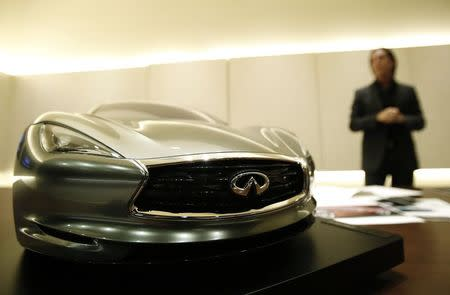 Infiniti chief designer Alfonso Albaisa stands behind a quarter sized model of the Infiniti Emerg E car during an interview with Reuters at Nissan Technical Center in Atsugi, south of Tokyo in this May 20, 2014 file photo. REUTERS/Yuya Shino/Files