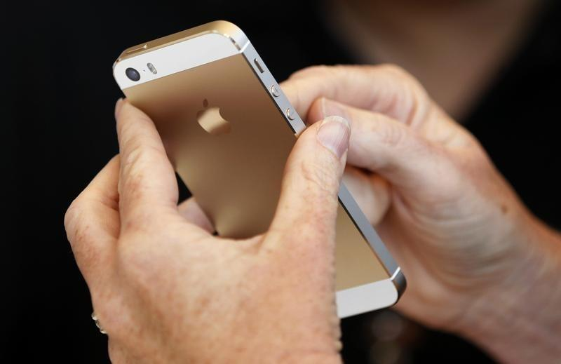 The gold colored version of the new iPhone 5S is seen after Apple Inc's media event in Cupertino