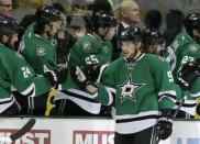 Dallas Stars center Tyler Seguin (91) is congratulated by Jordie Benn (24) and the rest of the bench following his first goal of the second period during an NHL hockey game against the Colorado Avalanche, Monday, Jan. 27, 2014, in Dallas. Seguin scored twice in the period. (AP Photo/Tony Gutierrez)