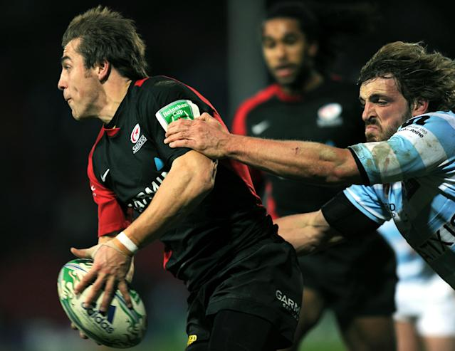Racing's Wing Mirco Bergamasco (R) prepares to tackle Saracen's Full Back Chris Wyles (L) during the Heineken Cup rugby union match between Saracens and Racing Metro 92 at Vicarage Road in Watford on December 11, 2010. Racing Metro 92 won the game 24-21. AFP PHOTO / Adrian Dennis (Photo credit should read ADRIAN DENNIS/AFP/Getty Images)