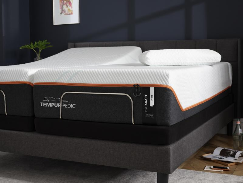 Bed with Tempur-Pedic mattress clearly labeled.