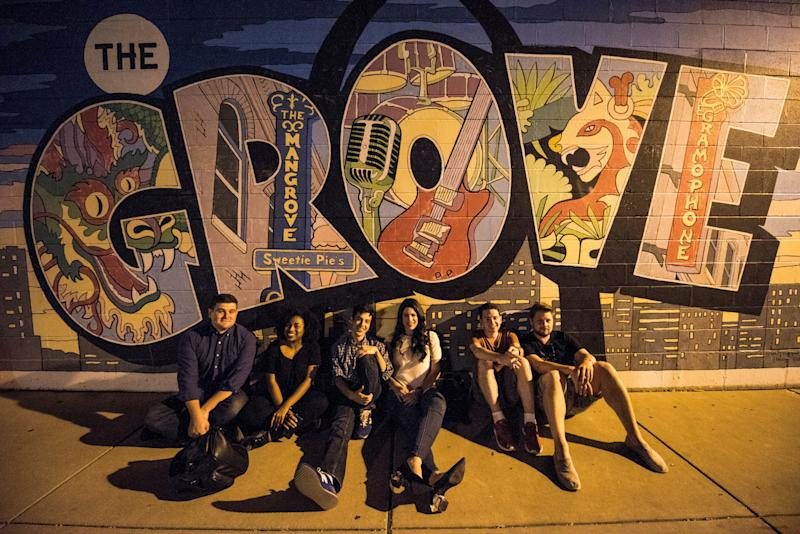 HuffPost staff in front of a mural at The Grove business district.