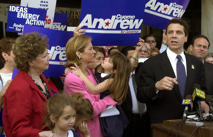 FILE — In this April 16, 2002 file photo, Andrew Cuomo, right, announces his intention to run for governor of New York, as his mother, Matilda, left, his daughters, in foreground, Mariah, 7, left, Cara, 7, second left, his wife, Kerry Kennedy Cuomo, and daughter Michaela, 4, center, stand at his side in Mineola, N.Y. New York's attorney general has promised a thorough investigation of allegations that Cuomo sexually harassed at least two women. (AP Photo/Ed Betz, File)