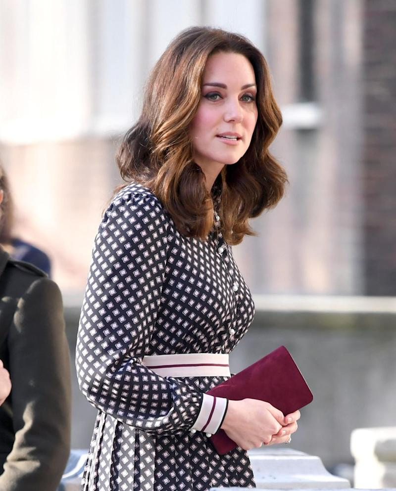 The Duchess showed off her growing bump in London yesterday. Photo: Getty