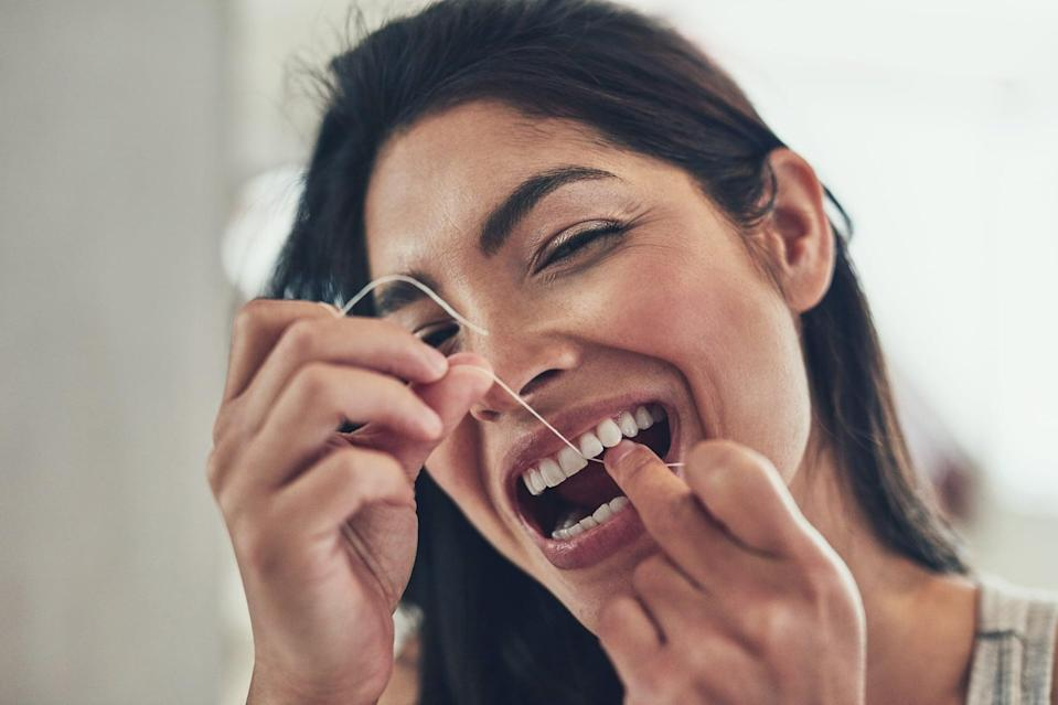 """<p>It may seem tedious, especially when you're super tired, but flossing daily and brushing your teeth for at least two minutes twice daily is crucial for <a href=""""https://www.popsugar.com/fitness/here-how-gingivitis-can-lead-to-periodontitis-47861636"""" class=""""link rapid-noclick-resp"""" rel=""""nofollow noopener"""" target=""""_blank"""" data-ylk=""""slk:maintaining good oral health"""">maintaining good oral health</a> and hygiene. If your smile doesn't motivate you, consider this: poor <a href=""""http://www.mayoclinic.org/healthy-lifestyle/adult-health/in-depth/dental/art-20047475"""" class=""""link rapid-noclick-resp"""" rel=""""nofollow noopener"""" target=""""_blank"""" data-ylk=""""slk:oral health has been linked to heart disease"""">oral health has been linked to heart disease</a>, pneumonia, and other health conditions. If it's not already part of your self-care routine, make it a goal in 2021 to floss daily and brush your teeth once in the morning and once before bed.</p>"""