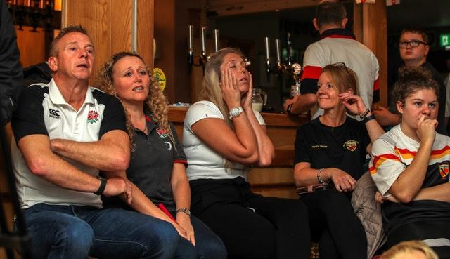 Dejected England fans at Crewe and Nantwich RFC
