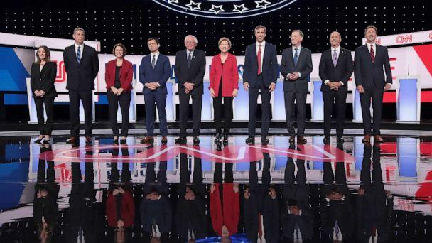 PHOTO: Democratic presidential candidates take the stage at the beginning of the Democratic Presidential Debate at the Fox Theatre, July 30, 2019, in Detroit. (Scott Olson/Getty Images)