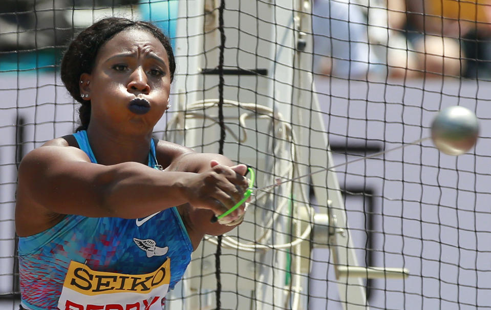 FILE - In this Sunday, May 21, 2017, file photo, Gwen Berry, of the United States, competes in the women's hammer throw at the Golden Grand Prix track and field event in Kawasaki, Japan. Gestures made at the Pan-Am Games in 2019 by Berry and fencer Race Imboden rekindled a contentious debate about the IOC's Rule 50. In a major shift in policy, the U.S. Olympic and Paralympic Committee has since committed to not sanction athletes who use their platform for social demonstrations. (AP Photo/Shizuo Kambayashi, File)