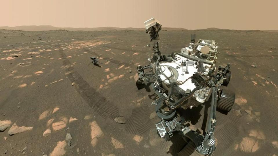 Perseverance rover stands in front of the Ingenuity helicopter for a selfie on Mars.