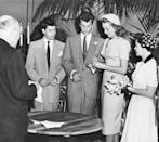 """<p>Actors Tony Curtis and Janet Leigh said """"I do"""" in an intimate ceremony in Greenwich, Connecticut in 1951. Here, the bride and groom are seen exchanging vows and rings as Janet Leigh wears a simple white suit and beaded cap. </p>"""