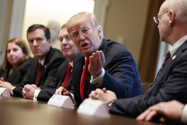 President Donald Trump speaks during a meeting with steel and aluminum executives in the Cabinet Room of the White House, Thursday, March 1, 2018, in Washington. From left, Beth Ludwig of AK Steel, Roger Newport of AK Steel, John Ferriola of Nucor, Trump, and Dave Burritt of U.S. Steel Corporation. (AP Photo/Evan Vucci)