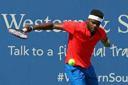 Aug 16, 2017; Mason, OH, USA; Frances Tiafoe (USA) returns a shot against  Alexander Zverev (GER) during the Western and Southern Open at the Lindner Family Tennis Center. Mandatory Credit: Aaron Doster-USA TODAY Sports
