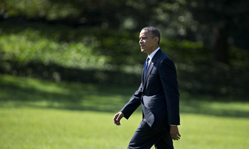 President Barack Obama walks on the South Lawn as he leaves the White House in Washington for a campaign trip to Virginia, Friday, Sept. 21, 2012. (AP Photo/Manuel Balce Ceneta)