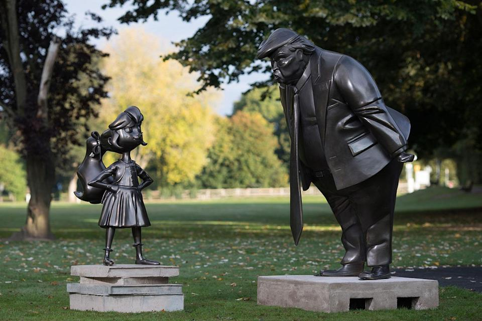 A statue of Roald Dahl's Matilda is unveiled in Great Missenden in Buckinghamshire, alongside one of President Donald Trump, to celebrate the 30th Anniversary of Matilda the novel. (David Parry/PA Wire/PA Images)