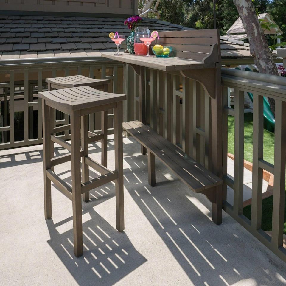 <p>The <span>Capri Wicker and Light Weight Concrete Patio Dining Set</span> ($230) attaches to your balcony for the ultimate space-saving solution.</p>