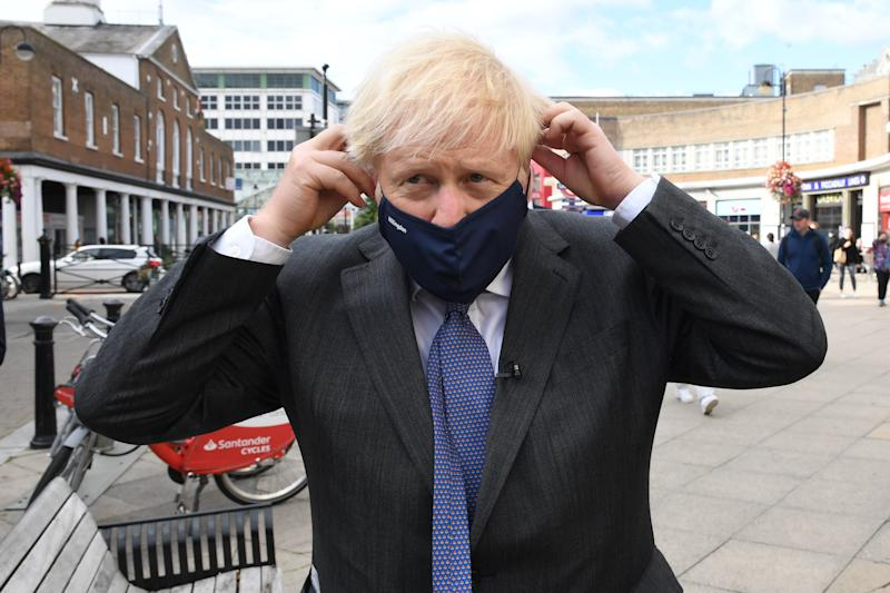 Prime Minister Boris Johnson meets shoppers and shopkeepers during a visit to his constituency in Uxbridge, west London.