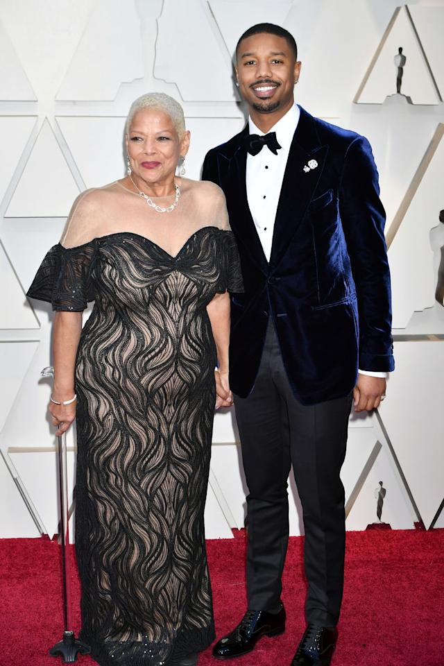 <p>The <em>Black Panther </em>star, who brought his mother to the award show, topped his tuxedo with a navy velvet smoking jacket. <em></em></p>