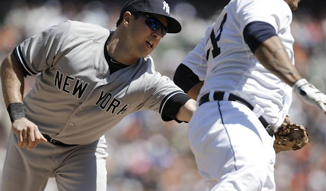 New York Yankees first baseman Mark Teixeira, left, reaches to tag Detroit Tigers' Miguel Cabrera out on a throw from shortstop Derek Jeter in the third inning of a baseball game in Detroit Thursday, Aug. 28, 2014. (AP Photo/Paul Sancya)