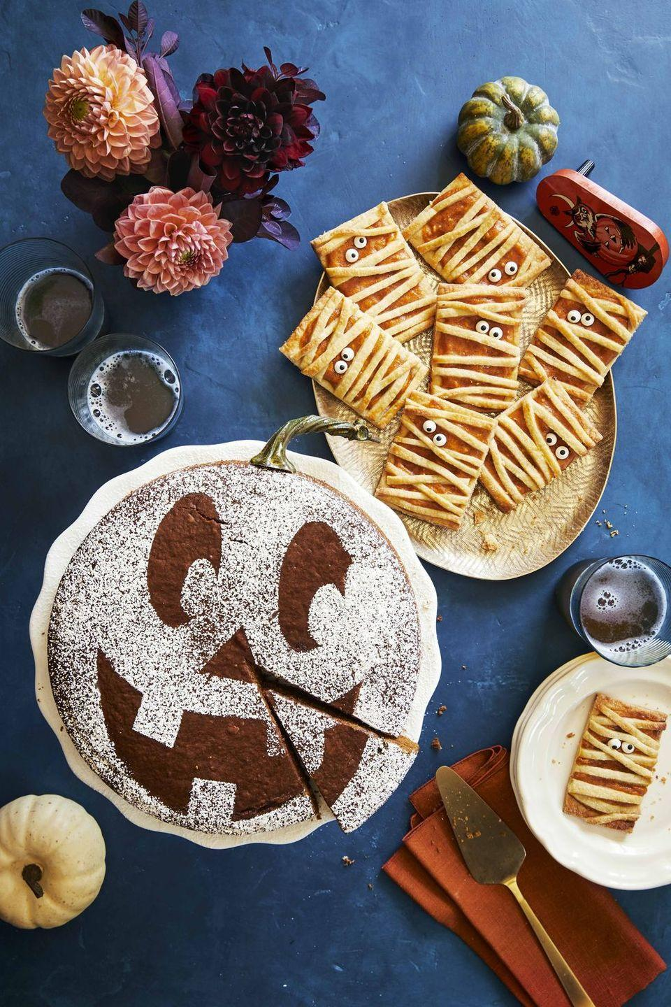 """<p>For a simple sweet, bake a richly spiced pumpkin cake, then use a jack-o'-lantern stencil to decorate with confectioners' sugar.</p><p><em><a href=""""https://www.countryliving.com/food-drinks/a33944277/spiced-pumpkin-molasses-cake/"""" rel=""""nofollow noopener"""" target=""""_blank"""" data-ylk=""""slk:Get the recipe from Country Living »"""" class=""""link rapid-noclick-resp"""">Get the recipe from Country Living »</a></em></p><p><strong>RELATED: </strong><a href=""""https://www.goodhousekeeping.com/food-recipes/dessert/g4547/pumpkin-cake-recipes/"""" rel=""""nofollow noopener"""" target=""""_blank"""" data-ylk=""""slk:21 Pumpkin Cakes That Celebrate Fall in the Best Way"""" class=""""link rapid-noclick-resp"""">21 Pumpkin Cakes That Celebrate Fall in the Best Way</a><br></p>"""