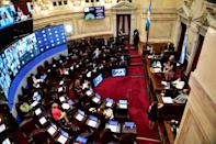 Argentina's Vice-President Cristina Fernandez de Kirchner (R) opens the session at the Senate to decide whether to legalize abortion, in Buenos Aires, on December 29, 2020