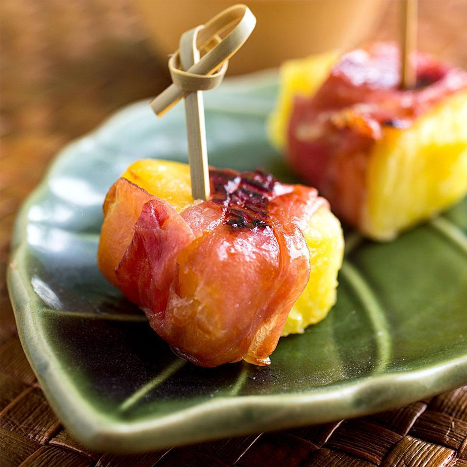 "<p>The sweet-and-salty combination in this easy, one-bite prosciutto-wrapped pineapple appetizer recipe is addictive. Double the recipe and serve it for a party. The ""bites"" taste best with fresh pineapple, but can also be made with canned pineapple chunks. <a href=""http://www.eatingwell.com/recipe/252186/prosciutto-wrapped-pineapple-bites/"" rel=""nofollow noopener"" target=""_blank"" data-ylk=""slk:View recipe"" class=""link rapid-noclick-resp""> View recipe </a></p>"