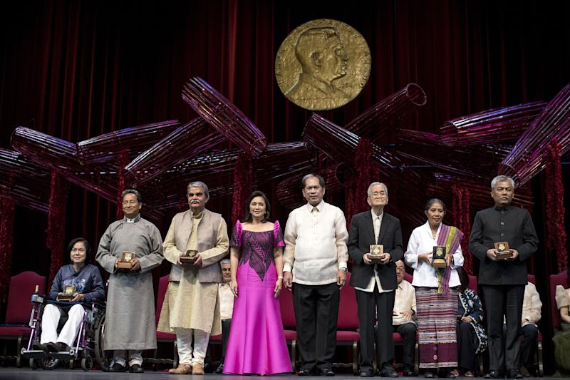 The 2018 Ramon Magsaysay Awardees, including, third form left, Bharat Vatwani of India, at the Cultural Center of the Philippines in Manila on August 31, 2018.