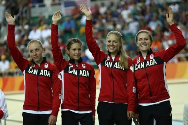 Simmerling, far right, after winning bronze as a member of Canada's pursuit cycling team at the Rio Olympics.