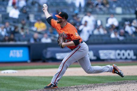 FILE PHOTO - Mar 30, 2019; Bronx, NY, USA; Baltimore Orioles pitcher Mike Wright (43) delivers a pitch during the ninth inning against the New York Yankees at Yankee Stadium. Mandatory Credit: Gregory J. Fisher-USA TODAY Sports