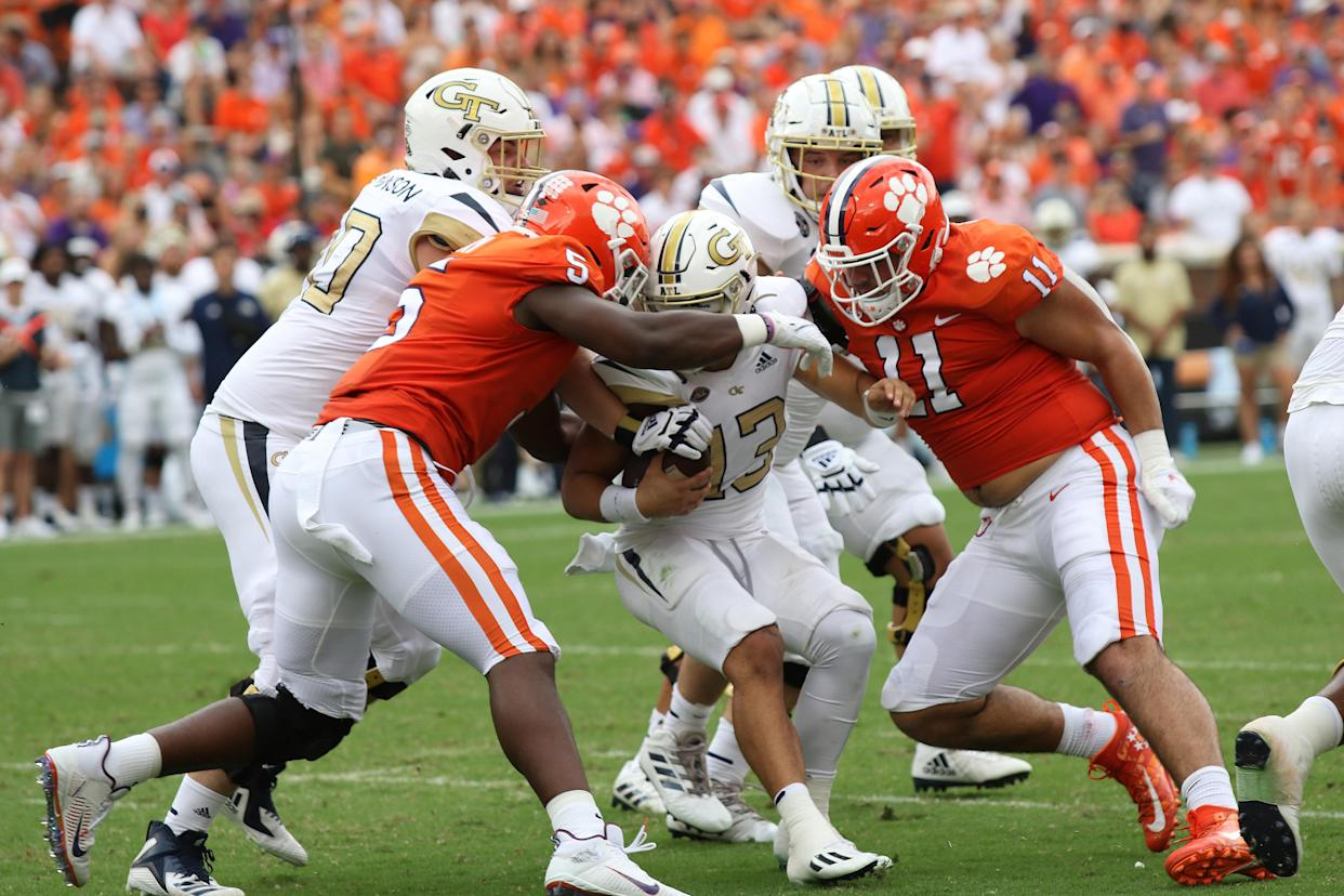 Clemson's K.J. Henry (5) and Bryan Bresee (11) come together to sack Georgia Tech's Jordan Yates (13) on Sept. 18, 2021. (John Byrum/Icon Sportswire)