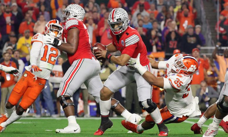 Ohio State's Justin Fields runs the ball against Clemson in the College Football Playoff.
