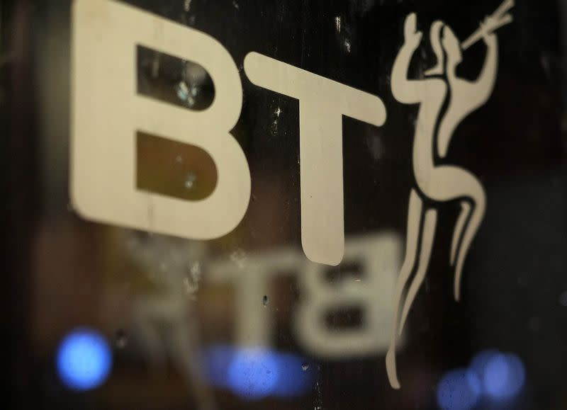 A BT logo is seen on the door of a telephone box in Manchester, northern England
