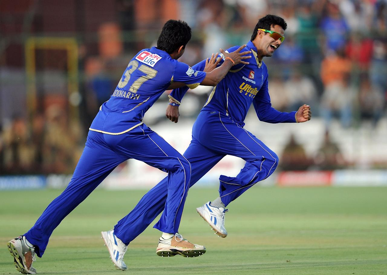 Rajasthan Royals bowler Ajit Chandila (R) celebrates taking the wicket of Pune warriors batsman Robin Uthappa during the IPL Twenty20 match between Rajasthan Royals and Pune Warriors at the Swai Mansingh stadium in Jaipur on May 13, 2012. RESTRICTED TO EDITORIAL USE. MOBILE USE WITHIN NEWS PACKAGE.  AFP PHOTO/Prakash SINGH        (Photo credit should read PRAKASH SINGH/AFP/GettyImages)