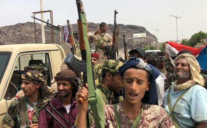Supporters of Yemeni separatists who say they have seized the presidential palace in Aden pose for a picture in the southern city on August 10, 2019 (AFP Photo/Nabil HASAN)